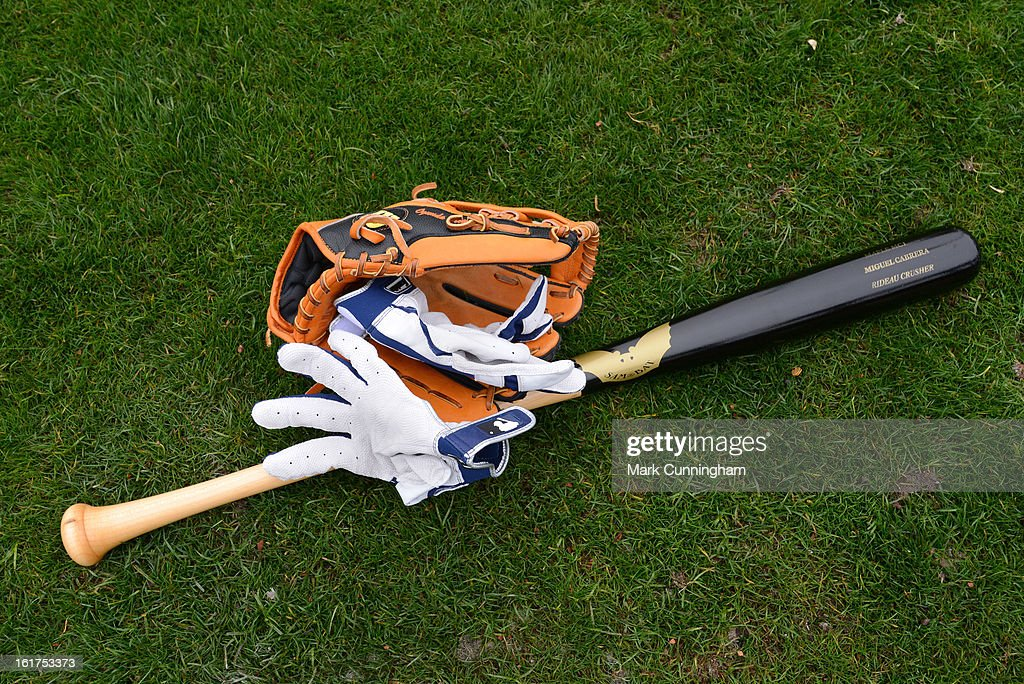 A detailed view of the baseball glove, bat and batting gloves of Miguel Cabrera #24 of the Detroit Tigers during Spring Training workouts at Joker Marchant Stadium on February 15, 2013 in Lakeland, Florida.