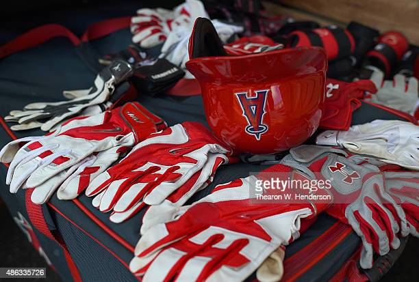 A detailed view of the batting gloves and a batting helmet belonging to the Los Angeles Angels of Anaheim sitting in the dugout prior to the game...