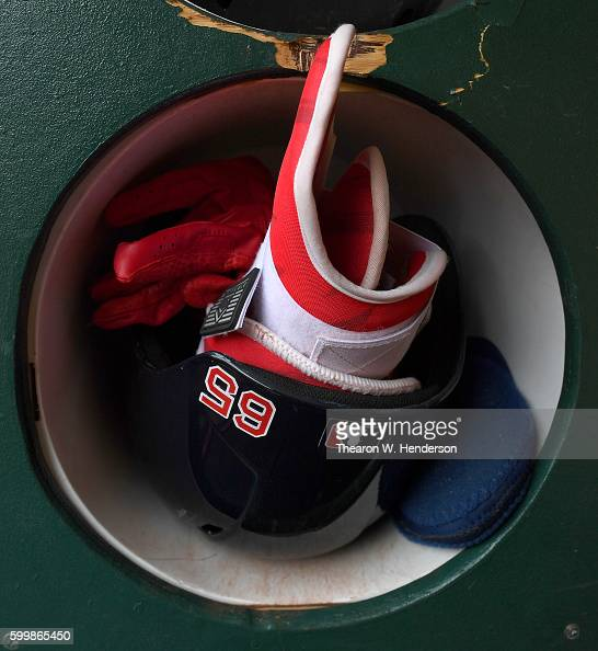 A detailed view of the batting helmet an shin guard belonging to Yoan Moncada of the Boston Red Sox sitting in the helmet rack prior to the start of...