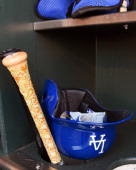A detailed view of the batting helmet and bats belonging to Yasiel Puig of the Los Angeles Dodgers sitting in the rack prior to the start of the game...