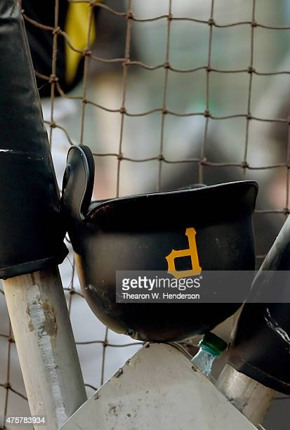 A detailed view of the batting helmet belonging to Josh Harrison of the Pittsburgh Pirates sits on the batting cage during batting practice prior to...