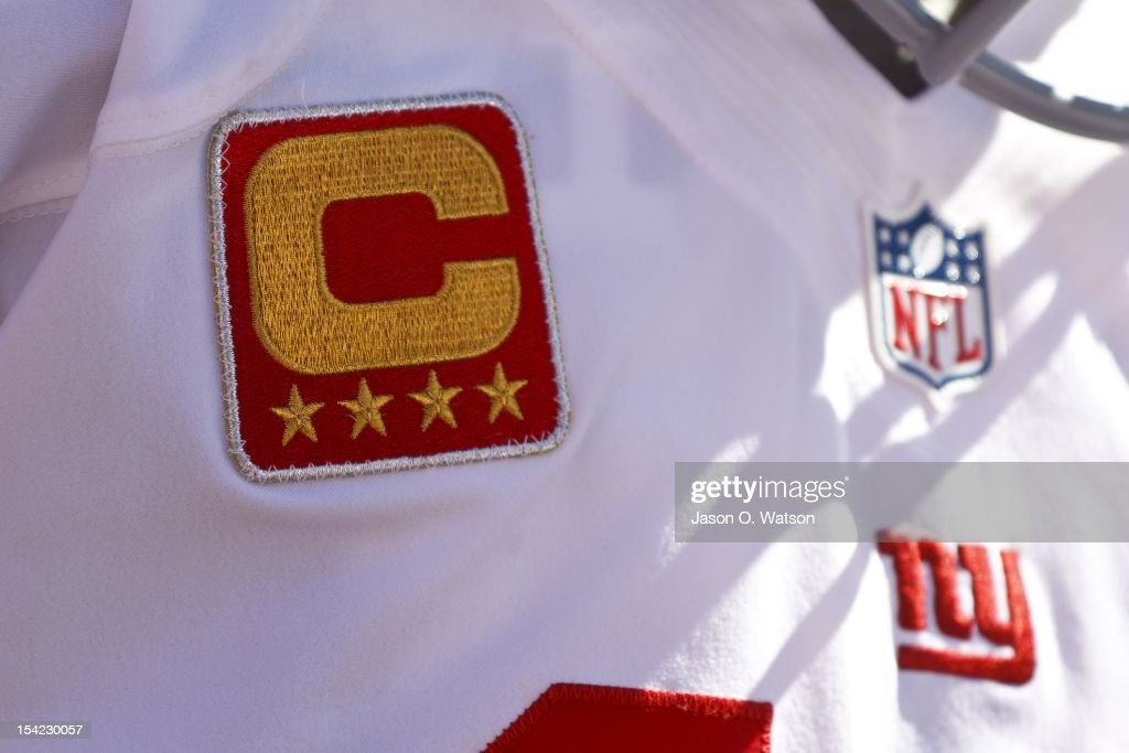 Detailed view of the captain's patch on the jersey of quarterback Eli Manning of the New York Giants before the game against the San Francisco 49ers...