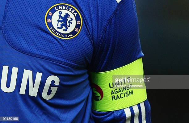 A detailed view of the Chelsea badge and 'Unite Against Racism' captain's armband worn by John Terry prior to the UEFA Champions League Group D match...