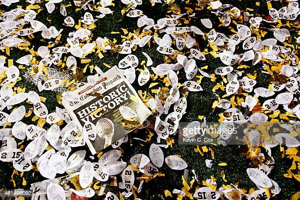 A detailed view of the Columbus Dispatch and 2015 confetti on the field after the Ohio State Buckeyes defeated the Oregon Ducks 42 to 20 in the...