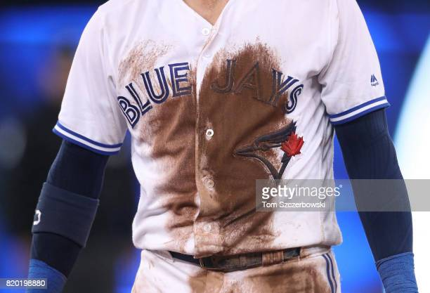 A detailed view of the dirt stain on the front of the jersey worn by Josh Donaldson of the Toronto Blue Jays during MLB game action against the...