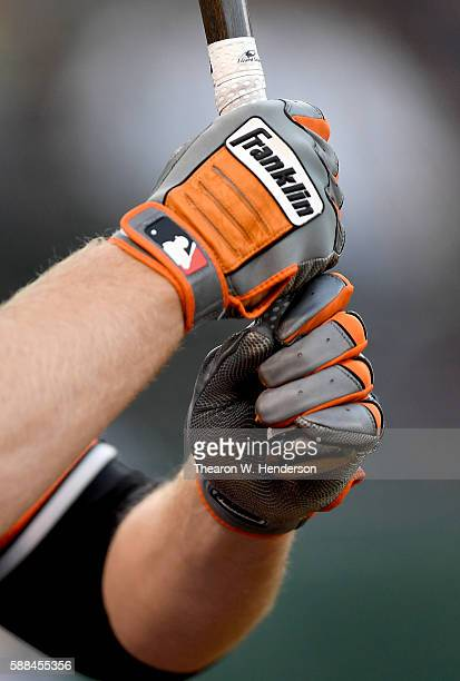 A detailed view of the Franklin batting gloves worn by Mark Trumbo of the Baltimore Orioles while holding his bat in the ondeck circle against the...