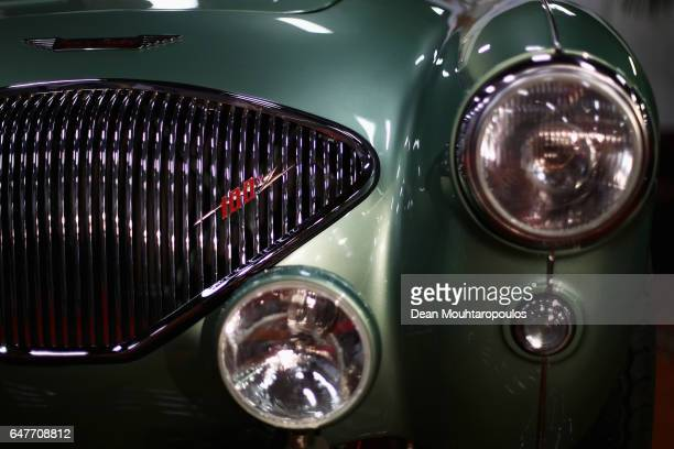 A detailed view of the front grill lights and badge on a Austin Healey 100M during the The 40th Antwerp Classic Salon run by SIHA Salons Automobiles...