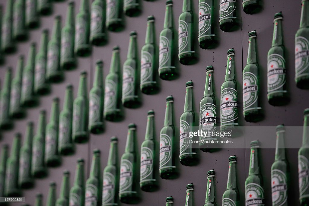 A detailed view of the Heineken Light Installation at Heineken Experience on December 7, 2012 in Amsterdam, Netherlands. Heineken marks its 140-year anniversary by inviting people to be part of the celebration in a major light installation on the wall of its spiritual home, brought to life through social media. Created from 5,000 iconic Heineken bottles the LED-lit exhibit will stand tall outside the Heineken Experience in the centre of Amsterdam, December 7th 2012- January 3rd 2013 as one of the Amsterdam Light Festival's highlights. As part of an open global party people are invited to share their own celebration messages through Facebook which will light up in a dynamic animated showcase, alongside bold images inspired by the brand's iconic history.