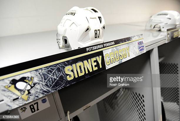 A detailed view of the helmet of Sidney Crosby of the Pittsburgh Penguins above his locker room stall is seen during the 2014 NHL Stadium Series...