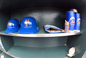 A detailed view of the helmets bat wieghts and pine tar rag belonging to the New York Mets sitting in the bat rack prior to the game against the San...