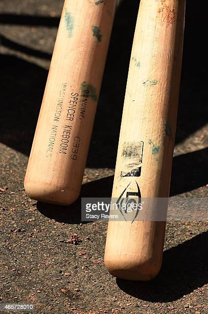 Detailed view of the Louisville Slugger bats used by Spencer Kieboom of the Washington Nationals prior to a spring training game against the Atlanta...