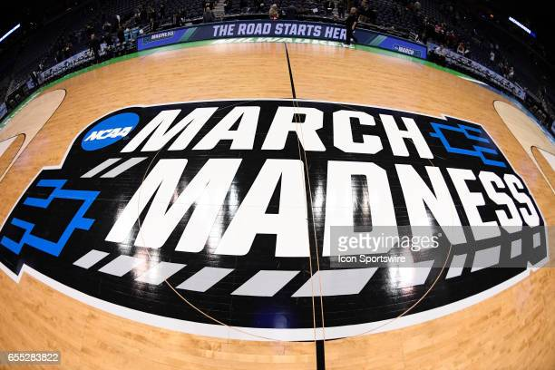 A detailed view of the March Madness logo on center of the basketball court is seen in the second half during the first round of the 2017 NCAA Men's...