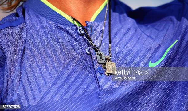A detailed view of the neckless of Denis Shapovalov of Canada during his mens singles match against Kyle Edmund of Great Britain during day one of...