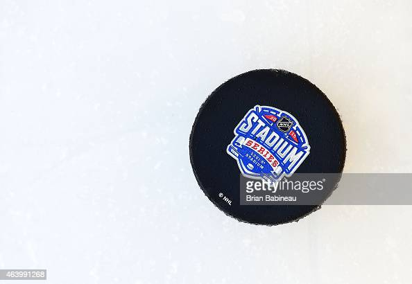 A detailed view of the official 2015 Stadium Series puck is seen on the ice during practice one day prior to the 2015 Coors Light Stadium Series game...