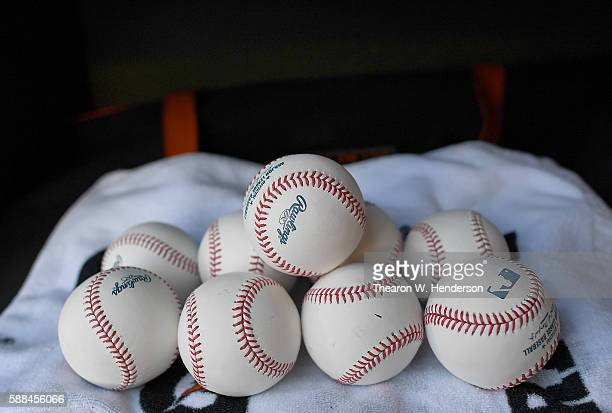 A detailed view of the Official Rawlings baseballs sitting on top of a Baltimore Orioles helmet bag prior to the start of the game against the...