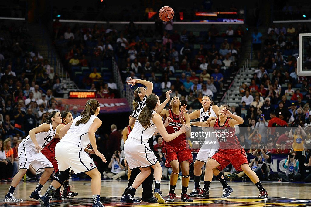 Detailed view of the opening tip between the Connecticut Huskies and the Louisville Cardinals to start the National Final game of the 2013 NCAA Division I Women's Basketball Championship at New Orleans Arena on April 9, 2013 in New Orleans, Louisiana.