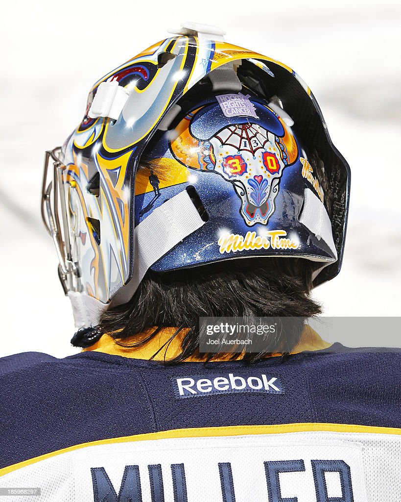 A detailed view of the rear of the mask of goaltender Ryan Miller #30 of the Buffalo Sabres displaying a sticker for 'Hockey Fights Cancer' prior to the game against the Florida Panthers at the BB&T Center on October 25, 2013 in Sunrise, Florida. The Sabres defeated the Panthers 3-1.