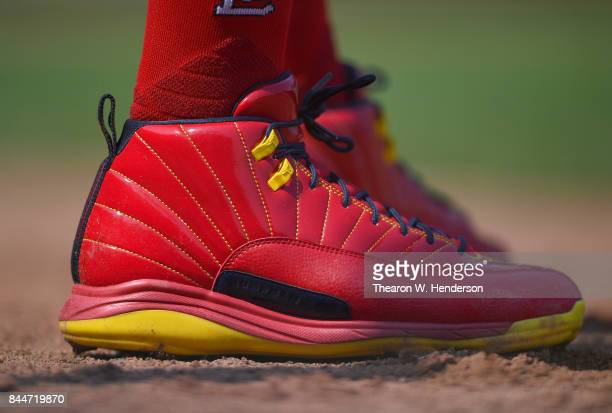 A detailed view of the red Nike Air Jordans XII baseball cleats worn by Dexter Fowler of the St Louis Cardinals against the San Francisco Giants in...