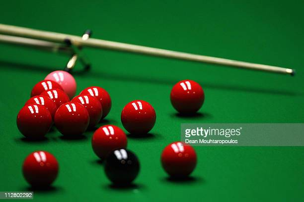 A detailed view of the rest cue red pink and black balls on the table during day six of the Betfredcom World Snooker Championship at The Crucible...
