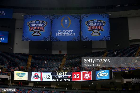 A detailed view of the scoreboard at the start of the fourth quarter with the score of Ohio State Buckeyes 42 to Alabama Crimson Tide 35 during the...
