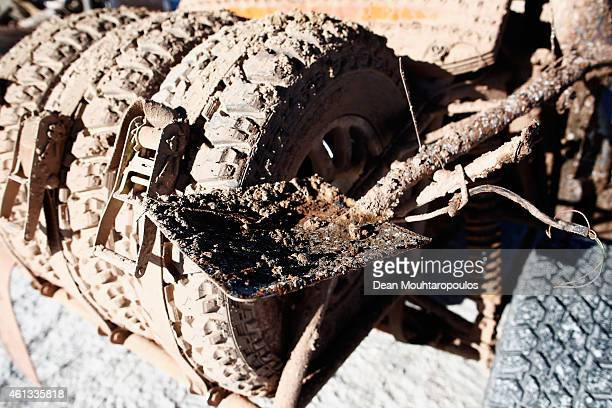 A detailed view of the shovel and spare tyres covered in mud dirt and salt on the vehicle of Alvaro Chicharro and Alvaro Chicharro Jnr of Chile for...