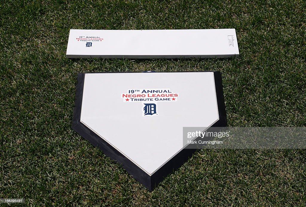 A detailed view of the special home plate and pitching rubber used in pre-game ceremonies prior to the Negro League Tribute Game between the Detroit Tigers and the Atlanta Braves at Comerica Park on April 27, 2013 in Detroit, Michigan. The Tigers defeated the Braves 7-4.