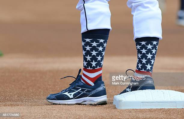 A detailed view of the special red white and blue socks to honor Independence Day worn by Andrew Romine of the Detroit Tigers during batting practice...