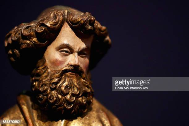 A detailed view of the St Peter statue made of walnut with partly original polychrmy in the Johan Maelwael special exhibition held at the Rijksmuseum...