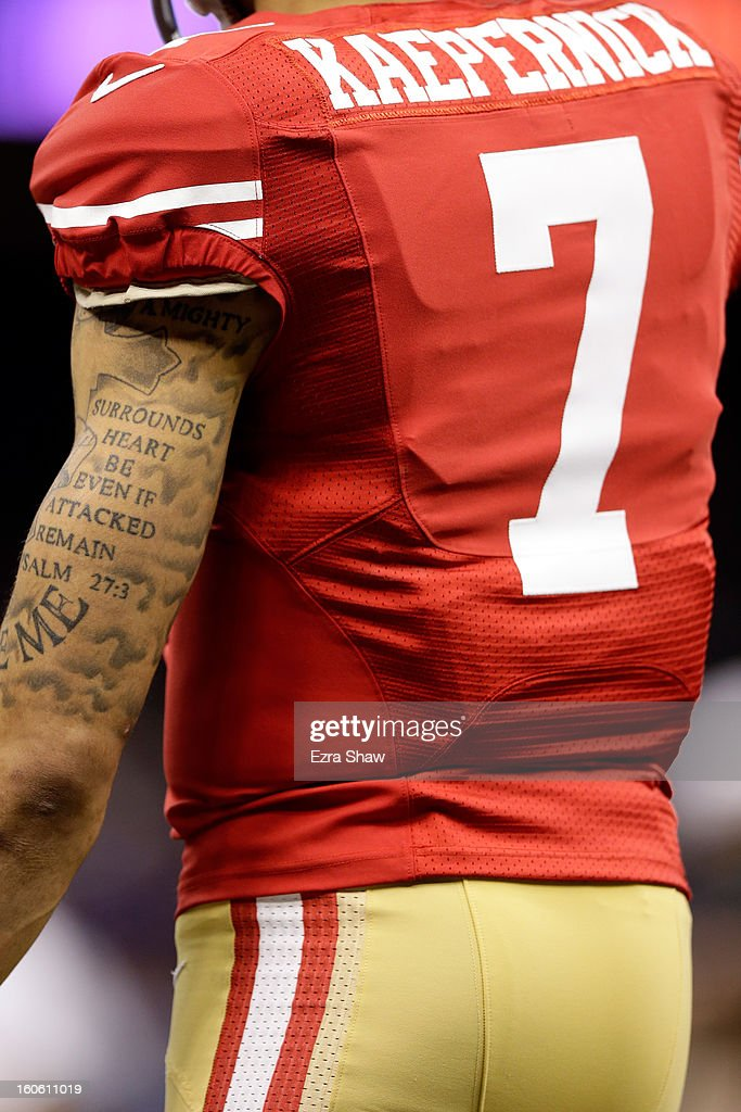 A detailed view of the tattoo's of Colin Kaepernick #7 of the San Francisco 49ers while he warms up on the field prior to Super Bowl XLVII against the Baltimore Ravens at the Mercedes-Benz Superdome on February 3, 2013 in New Orleans, Louisiana.