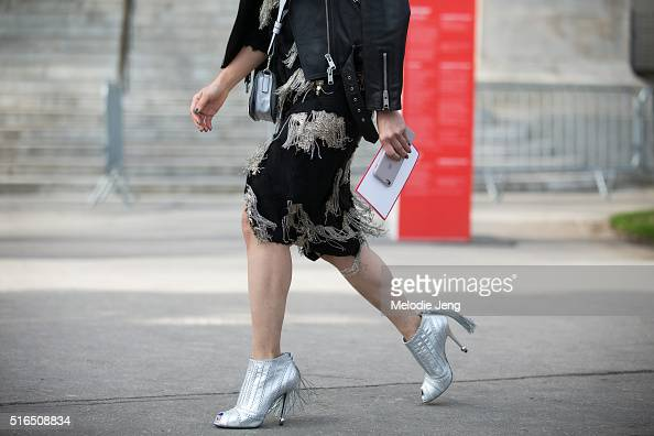 a dress with a metallic fringe and silver heels with a fringe are spotted at the Chanel show at Grand Palais on March 07 2016 in Paris France