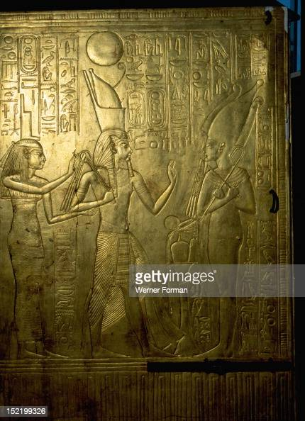 Details from Tutankhamuns shrine in the form of the second sactuary of the South Tutankhamun followed by the goddes Isis faces the god of the dead...