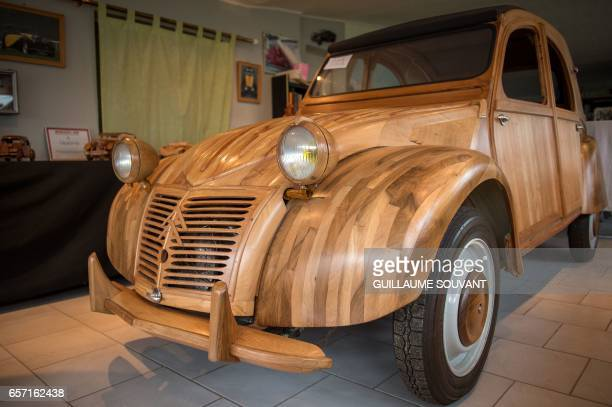 Details of a handbuilt wooden 2CV Citroen Car built as an exact one/one replica are pictured on March 20 near Loches Central France A retired...