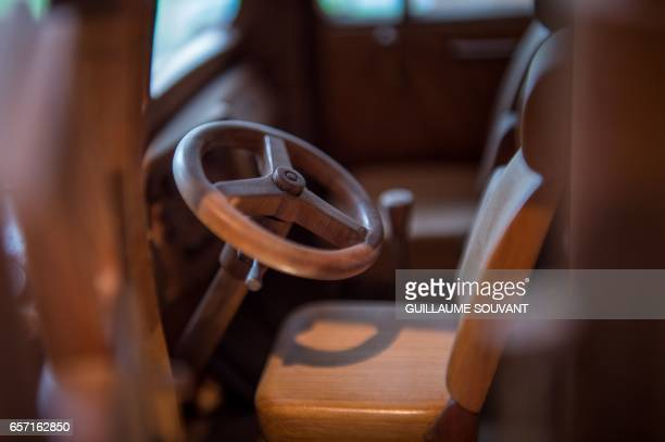 Details of a wooden model built by French cabinet maker Michel Robillard in his workshop on March 20 near Loches Central France A retired...