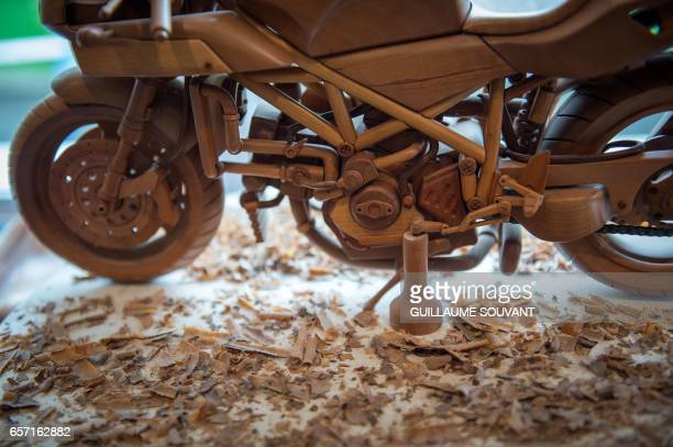 Details of a wooden model built by French cabinetmaker Michel Robillard in his workshop are pictured on March 20 near Loches Central France A retired...