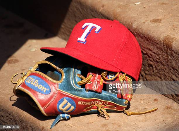 A details view of Rougned Odor of the Texas Rangers glove and cap in the dugout during the fifth inning against the Los Angeles Angels of Anaheim at...