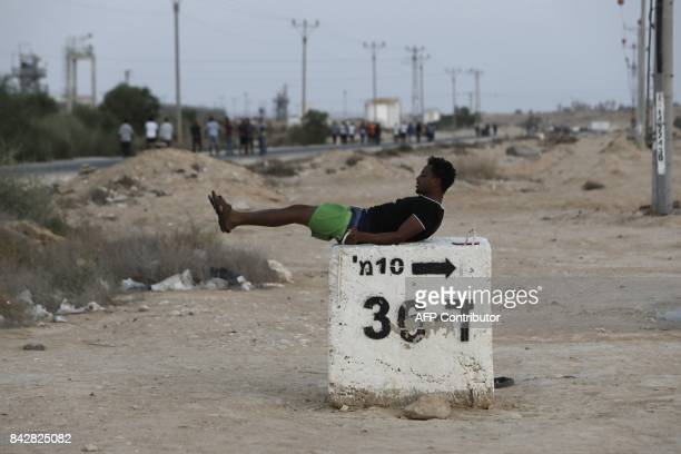 A detained African illegal immigrant excercises during his free time outside the Holot detention center in Israel's southern Negev desert near the...
