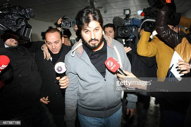 Detained Azerbaijani businessman Reza Zarrab is surrounded by journalists as he arrives at a police center in Istanbul on December 17 2013 Turkish...