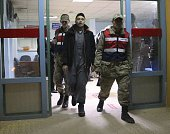 Detained British people leave an hospital after they undergo medical check up and fingerprinting in Hatay southern of Turkey on April 02 2015 Nine...