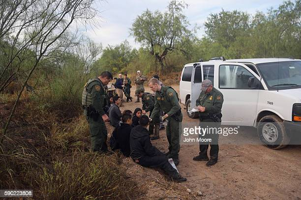 Detained immigrants are questioned after being captured by US Border Patrol agents on August 16 2016 in Roma Texas Border security has become a main...