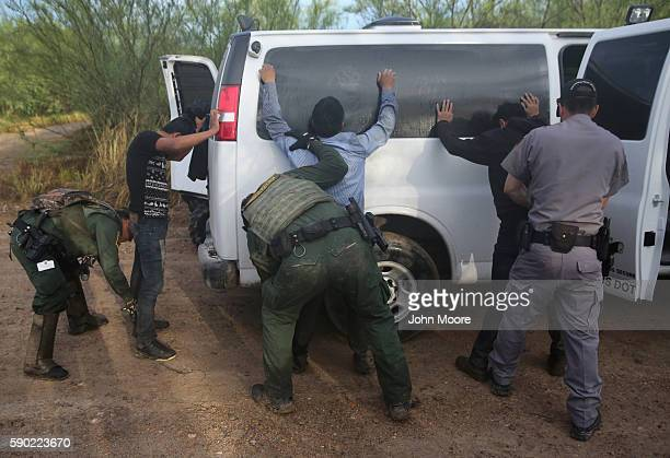 Detained immigrants are searched after being captured by US Border Patrol agents on August 16 2016 in Roma Texas Border security has become a main...