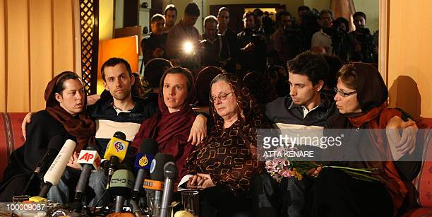 Detained US hikers Shane Bauer Sarah Shourd and Josh Fattal sit with their mothers during their first meeting since their arrest in the Iranian...