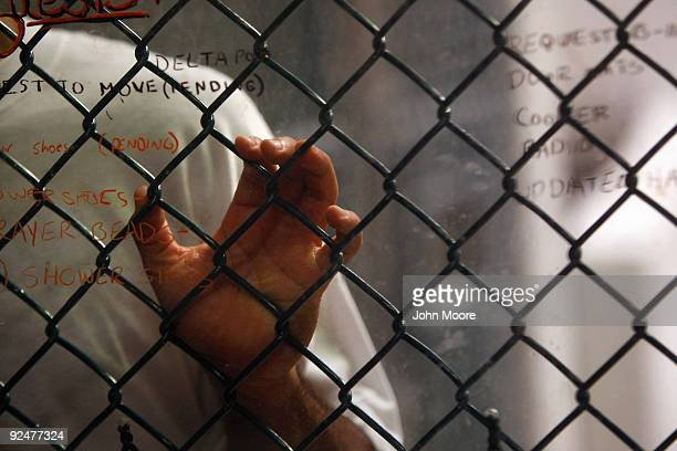 A detainee stands at an interior fence at the US military prison for 'enemy combatants' on October 28 2009 in Guantanamo Bay Cuba Although US...