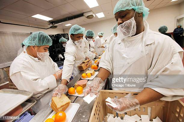 Detainees assemble lunch meals in the prep room of the kitchen at the Cook County Correctional Center in Chicago Illinois Friday April 15 where...