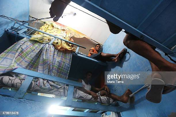 Detainees pose in their cell in the overcrowded Desembargador Raimundo Vidal Pessoa penitentiary inaugurated in 1904 on June 23 2015 in Manaus...