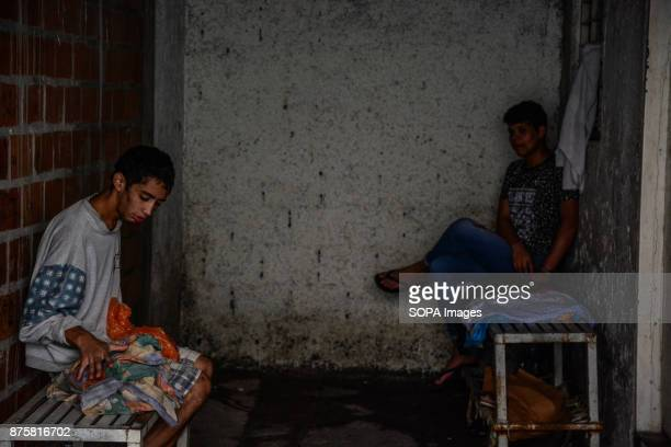 2 detainees remain handcuffed to a chairs outside of a police precinct cell Currently the conditions of these prisons violate all the human rights of...