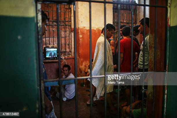 Detainees spend time in a holding cell in the overcrowded Desembargador Raimundo Vidal Pessoa penitentiary inaugurated in 1904 on June 23 2015 in...