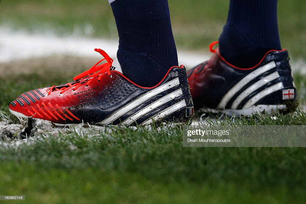 A detalied view of the boots worn by David Beckham of PSG with the England and France Flag as well as his childrens names, Romeo, Brooklyn, Cruz and Harper on them during the French Cup match between Paris Saint-Germain FC and Marseille Olympic OM at Parc des Princes on February 27, 2013 in Paris, France.