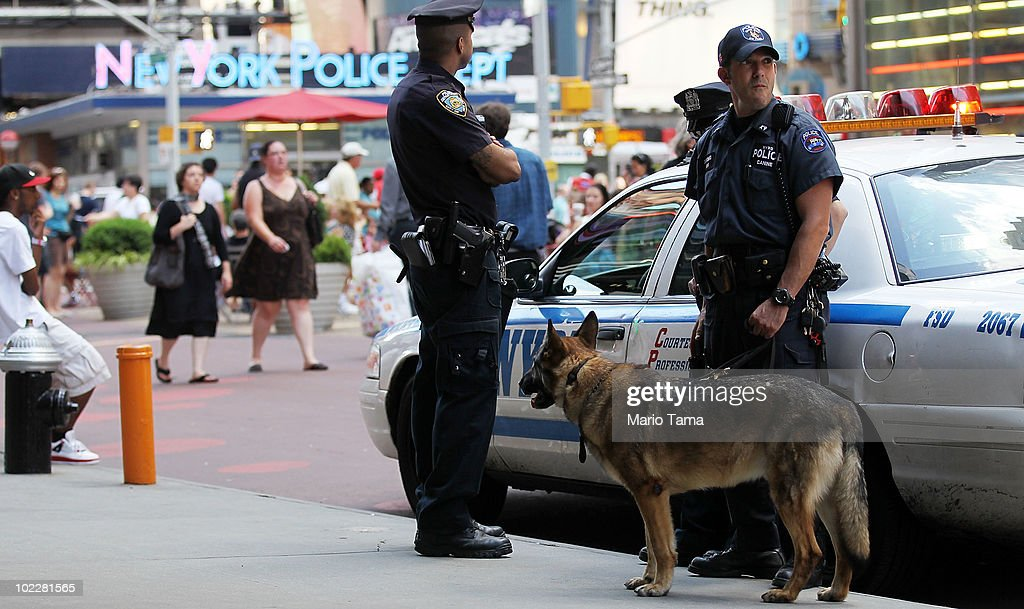 Detective Bonomo (R) and police canine Hunter keep watch in Times Square June 21, 2010 in New York City. Accused Times Square bomber Faisal Shahzad pleaded guilty on June 21 to all terror and weapons charges.