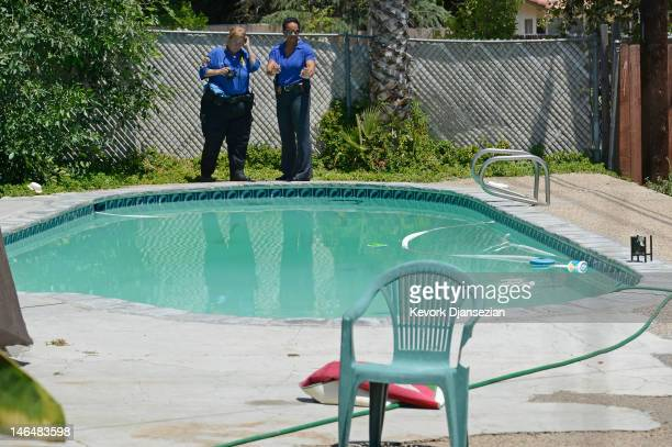 Detective Carla McCullough with Rialto Police directs police technician Noretta Barker as they investigate the death of Rodney King on June 17 2012...