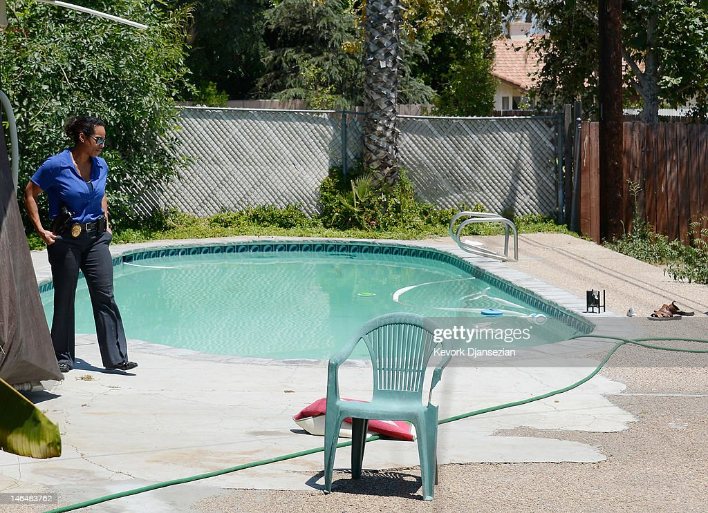 Detective Carla McCullough with Rialto Police investigates the death of Rodney King who was found in his pool on June 17, 2012 in Rialto, California. King, whose video beating by Los Angeles police in 1991 sparked riots after the acquittal of the four officers involved, was found dead at the age of 47 from an apparent drowning in his swimming pool.